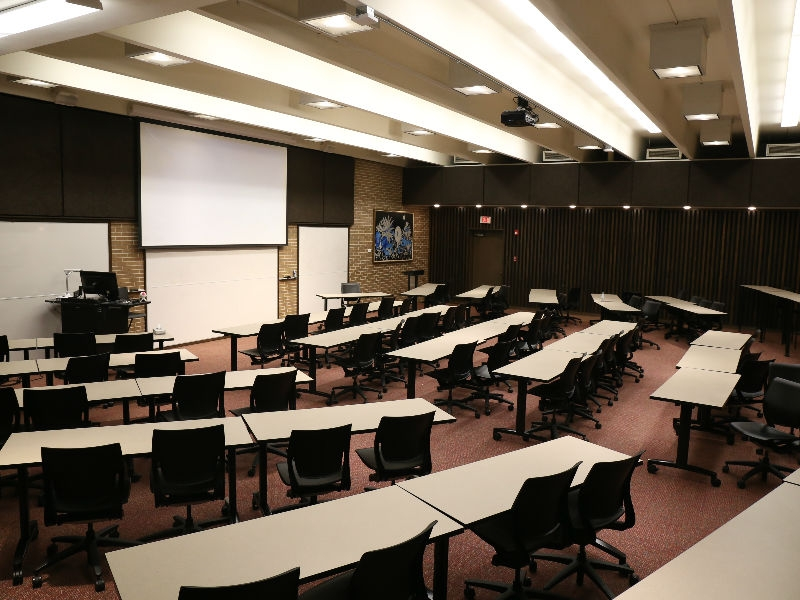 Classroom (Todd Wehr 104) with desks, chairs and whiteboard